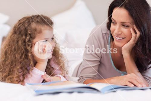 Mother reading a bedtime story for her daughter
