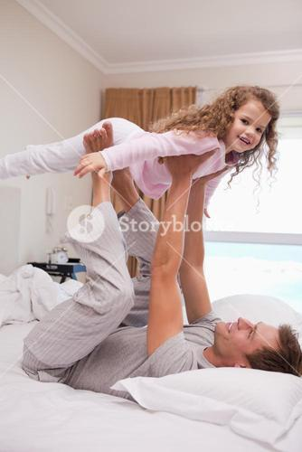 Father letting his daughter fly