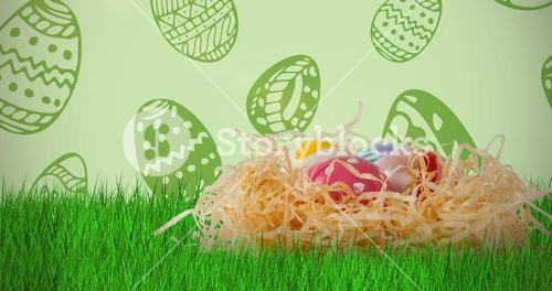 Composite image of easter eggs in creative paper nest