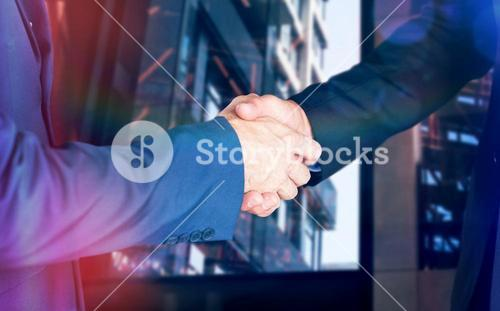 Composite image of male executives shaking hands