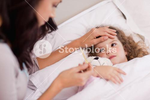 Mother taking care of her sick daughter
