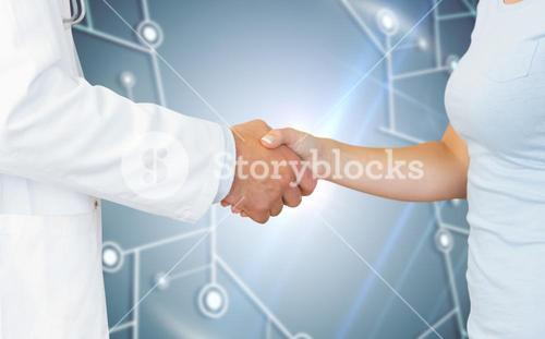 Composite image of doctor and patient shaking hands