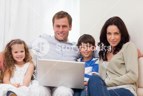 Family surfing the internet in the living room together