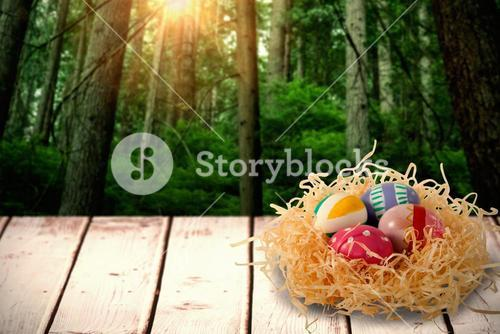 Composite image of patterned easter eggs in paper nest