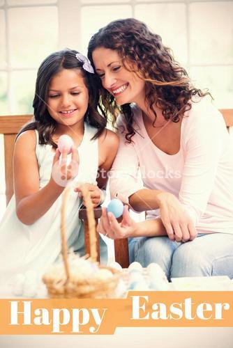 Composite image of happy mother and daughter holding easter eggs