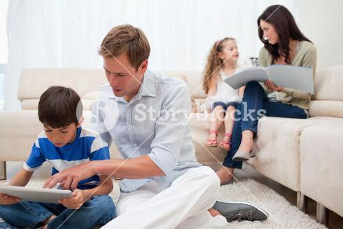 Family spending spare time in the living room