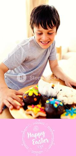 Composite image of happy boy looking at confectionery