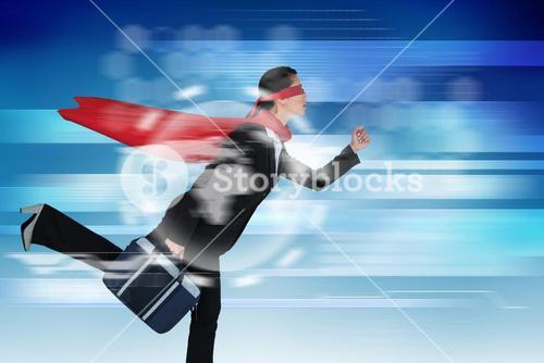 Composite image of businesswoman running while pretending to be super hero