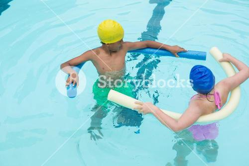 Two kids swimming in pool