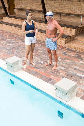 Swim coach interacting with senior man