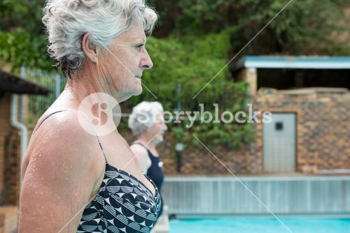Senior women standing at poolside