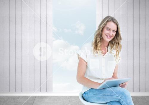 Woman with tablet and opening to sky