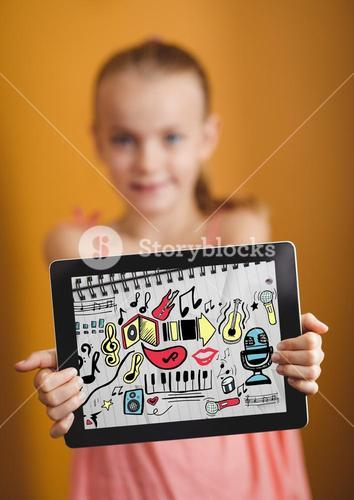 Kid against yellow wall holding tablet showing music doodles on sketchbook