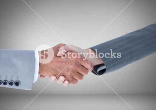 Handshake of Business people against grey background