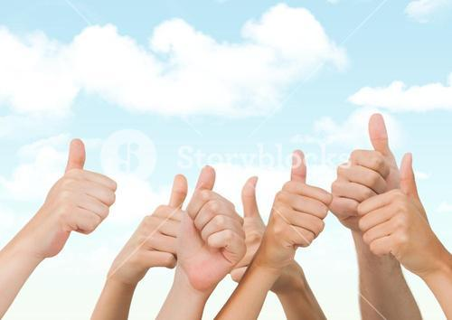 Many hands thumbs up against blue sky