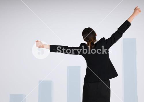 Businesswoman with arms stretched widely against charts incrementing