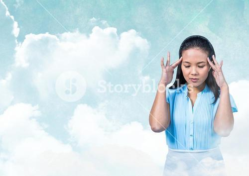 Woman with hands on head peaceful meditative in cloudy sky