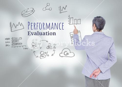 Businesswoman touching Performance Evaluation text with drawings graphics