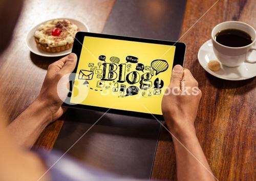 Hands with tablet showing black blog doodles against yellow background