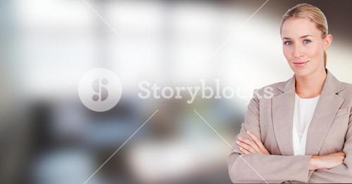 Busines woman with hands folded  on blurred background