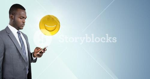 Business man on phone with emoji and flare against blue background