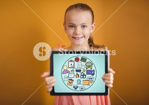 Kid against yellow wall holding tablet showing school doodles and blue background