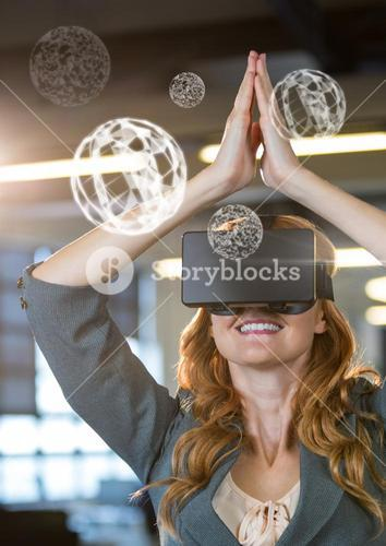 Woman wearing VR Virtual Reality Headset with Interface Orbs