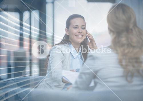 Business woman on phone behind arrow graphic overlay