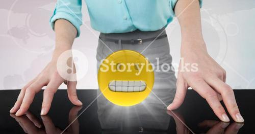 Close up of business woman's hands on table with emojis and flare against white interface