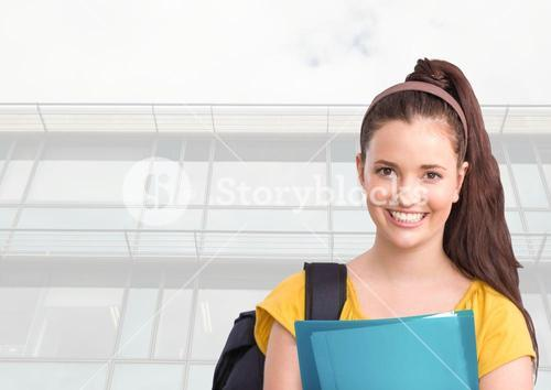Female student in front of college windows