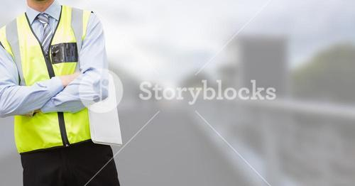 Traffic controller with his hands folded on blurred background of the city