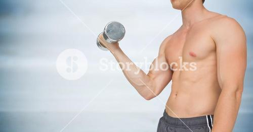 Man mid section weightlifting against blurry blue wood panel