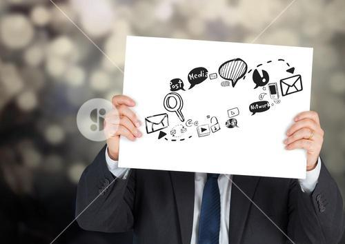 Businessman holding card with social media graphic drawings
