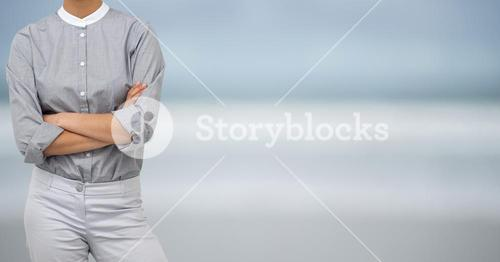 Business woman with grey clothes on blue blurred background