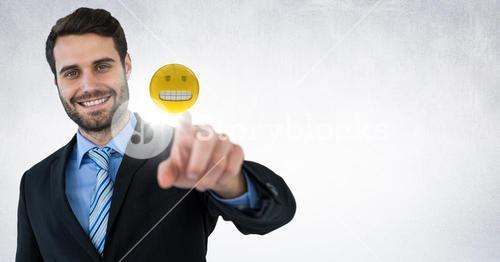 Business woman touching emoji and flare against white wall