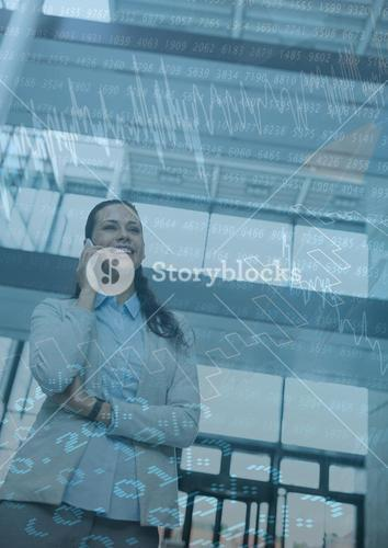 Business woman with phone and blue chart graphic overlay