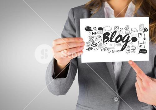 Businesswoman holding card with blog social media graphics drawings