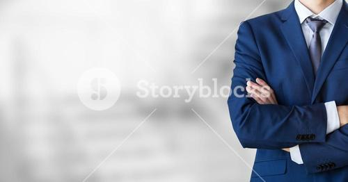 Business man with blazer and his hands folded on blurred background