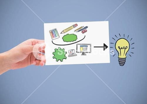 Hand holding card with creative design graphics drawings ideas