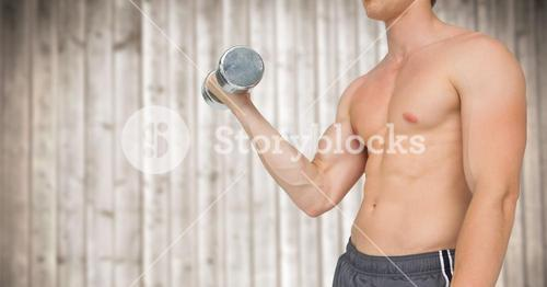 Man mid section weightlifting against blurry wood panel