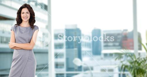 business woman with her hands folded on blurred backs.
