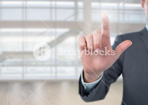 Businessman touching air in front of glass room