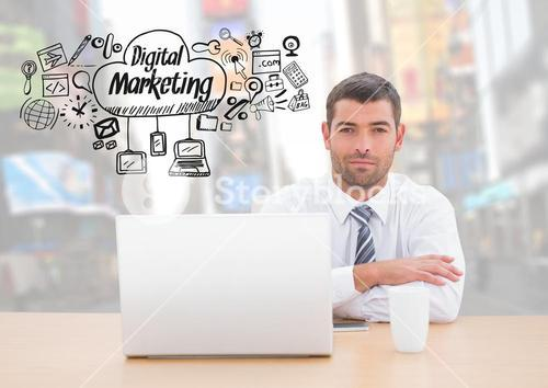 Man with laptop and Digital Marketing text with drawings graphics