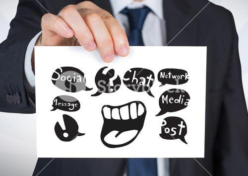 Hand holding card with chat social media graphic drawings