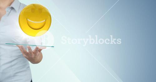Business woman mid section with tablet and emoji and flare against blue background