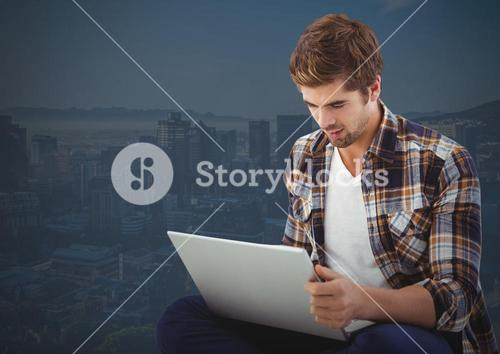 Man sitting with laptop with dark background