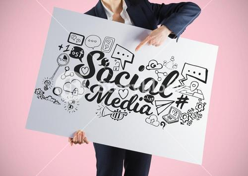 Businesswoman holding card with funny face and social media graphics drawings