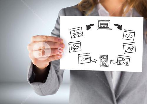 Businesswoman holding card with computer screens graphics drawings