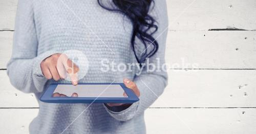Woman mid section with tablet against white wood panel