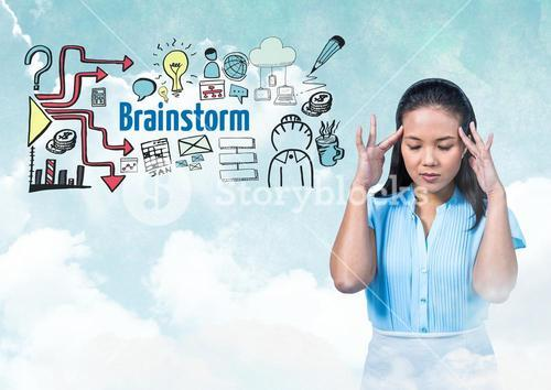 Woman with hands touching head and Brainstorm text with drawings graphics